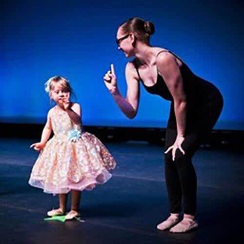 Darby's dancers about on stage image with teacher and toddler