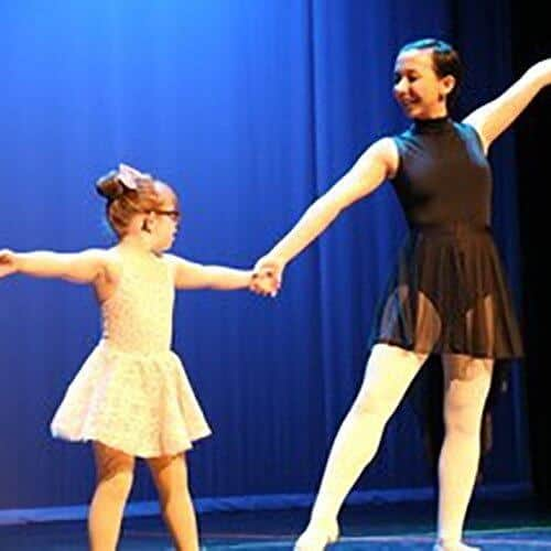 Darby's dancers about on stage student and teacher