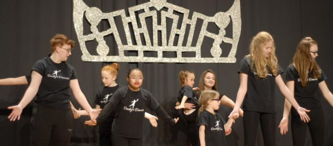 Members of the Darby's Dancers program dance on stage at the Miss Jefferson County pageant on Feb. 8. Darby's Dancers is a nationwide dance organization for children with disabilities.  Journal photo by Mikayla Hamrick